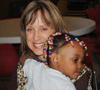 HUGS for volunteer Joan Haan from a young Project Home guest.