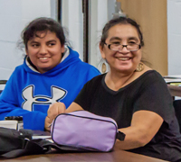 Juanita Espinosa (right) and her daughter attending a recent FEDS session.